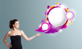 young woman presenting abstract speech bubble copy space Stock Photos