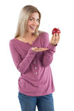 Young woman presenting an apple Royalty Free Stock Photo