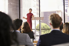 Young woman presenting business seminar gestures to audience stock photos