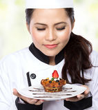 Young woman presenting Chef Royalty Free Stock Image