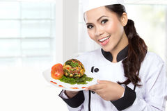 Young woman presenting Chef Stock Photography