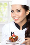 Young  woman presenting Chef Stock Photos