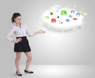 Young woman presenting cloud with colorful app Royalty Free Stock Image