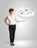 Young woman presenting cloud with colorful app icons and symbols Stock Image
