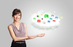 Young woman presenting cloud with colorful app icons and symbols Stock Photos