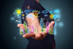 Young woman presenting colorful hand drawn metropolitan city Stock Image
