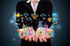 Young woman presenting colorful hand drawn metropolitan city Stock Photography