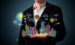 Young woman presenting colorful hand drawn metropolitan city Stock Photo
