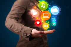 Young woman presenting colorful technology icons and symbols Royalty Free Stock Photo