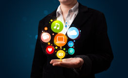 Young woman presenting colorful technology icons and symbols Royalty Free Stock Photography