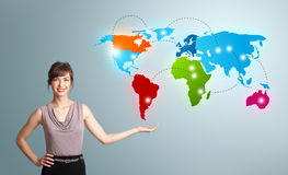 Young woman presenting colorful world map Royalty Free Stock Photo