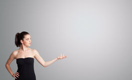 Young woman presenting copy space Royalty Free Stock Images