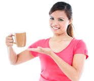 Young Woman Presenting Cup Royalty Free Stock Photography