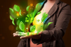 Young woman presenting eco green leaf recycle energy concept Royalty Free Stock Photos