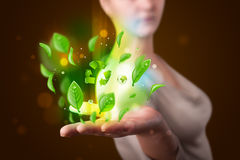 Young woman presenting eco green leaf recycle energy concept Royalty Free Stock Photo