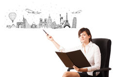Young woman presenting famous cities and landmarks Royalty Free Stock Image