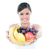 Young Woman Presenting Fruits Royalty Free Stock Image
