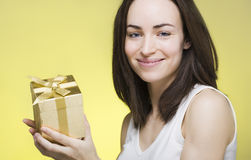Young woman presenting  gift box Royalty Free Stock Images