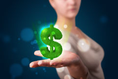 Young woman presenting green glowing dollar sign. Young beautiful woman presenting green glowing dollar sign Royalty Free Stock Image