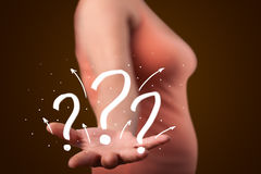 Young woman presenting hand drawn question marks Stock Photography