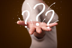 Young woman presenting hand drawn question marks Stock Photo