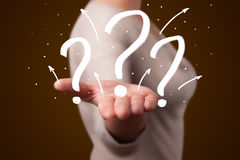 Young woman presenting hand drawn question marks Royalty Free Stock Image