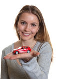 Young woman presenting her first car Stock Images