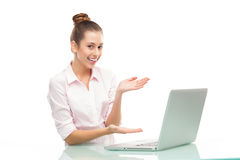 Young woman presenting laptop Royalty Free Stock Image