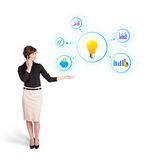 Young woman presenting light bulb with colorful graphs and diagr Royalty Free Stock Photography
