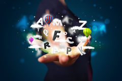 Young woman presenting magical abstract clouds and balloons conc Stock Images