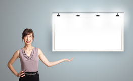 Young woman presenting modern copy space Royalty Free Stock Image