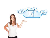 Young woman presenting modern devices in clouds. Beutiful young woman presenting modern devices isolated on white Royalty Free Stock Photo