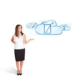 Young woman presenting modern devices in clouds Stock Photography