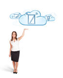 Young woman presenting modern devices in clouds Royalty Free Stock Photography