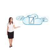 Young woman presenting modern devices in clouds Royalty Free Stock Photo