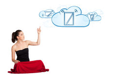 Young woman presenting modern devices in clouds. Beutiful young woman presenting modern devices isolated on white Royalty Free Stock Images