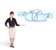 Young woman presenting modern devices in clouds Stock Photos