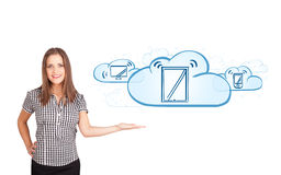 Young woman presenting modern devices in clouds Stock Image