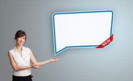 Young woman presenting modern speech bubble copy space Stock Images