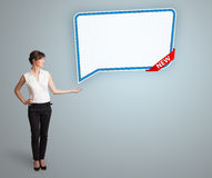 Young woman presenting modern speech bubble copy space Stock Photography
