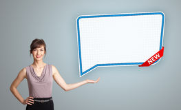 Young woman presenting modern speech bubble copy space Royalty Free Stock Photography