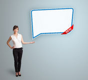 Young woman presenting modern speech bubble copy space Royalty Free Stock Images