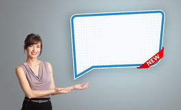 Young woman presenting modern speech bubble copy space Royalty Free Stock Image