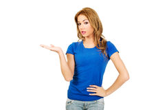 Young woman presenting a product. Stock Photos