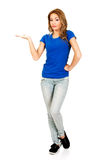 Young woman presenting a product. Royalty Free Stock Photo