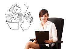 Young woman presenting recycle globe on whiteboard Royalty Free Stock Images