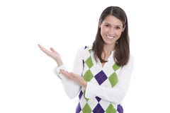 Young woman presenting or showing something with her isolated ha Stock Photo