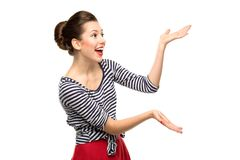 Young woman presenting something Royalty Free Stock Image