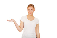 Young woman presenting something on open palm Stock Photography