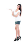 Young Woman Presenting Things Stock Photography